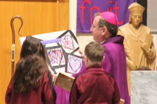 Bishop McClory visiting St. Thomas More School