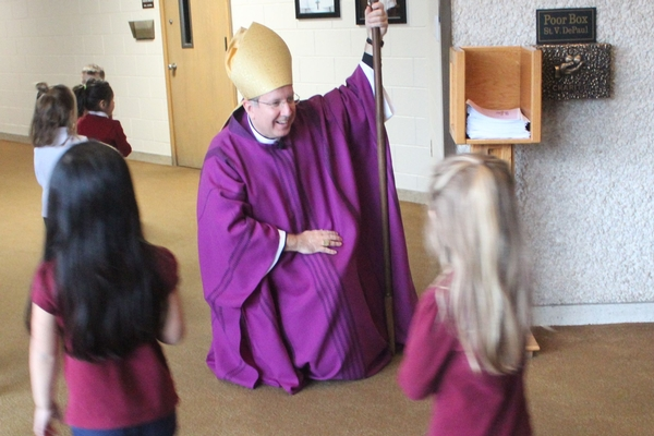 Bishop McClory greeting students after Mass